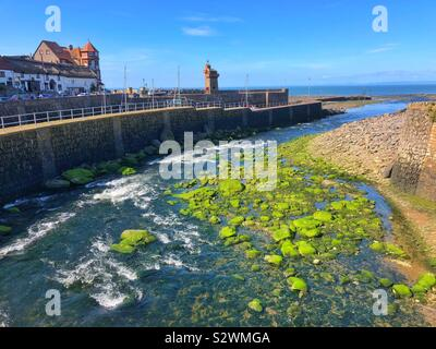 Lynmouth, North Devon, on the confluence of the East Lyn and West Lyn Rivers as they merge to join the sea. - Stock Photo