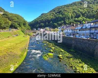 Lynmouth, on the river Lyn where it joins the sea, North Devon, August. - Stock Photo