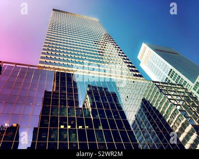 Reflections of skyscrapers on the glass façade of 300 Madison Ave., headquarters for PWC at 42nd St. in midtown Manhattan, NYC, USA - Stock Photo