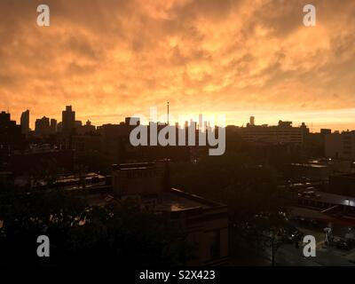 Photo of Manhattan after the storm during the sunset taken from Brooklyn (no filter) - Stock Photo
