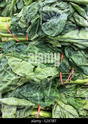 Fresh spinach for sale. - Stock Photo