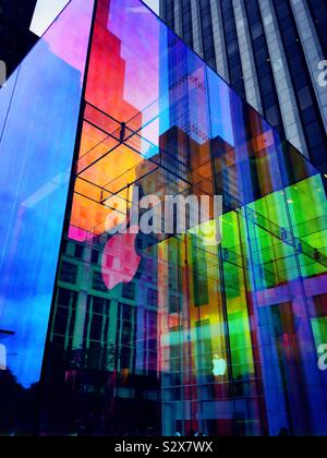 The iconic Apple store cube on fifth Avenue is covered in a temporary iridescent wrap, NYC, USA - Stock Photo