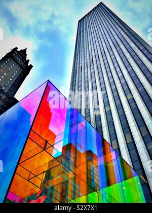 The iconic Apple store cube is located at the GM building across from the Sherry Netherland's in New York City. - Stock Photo