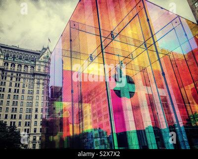 The iconic Apple store cube wrapped in iridescent colors is located across from the famous plaza hotel, United States, NYC - Stock Photo
