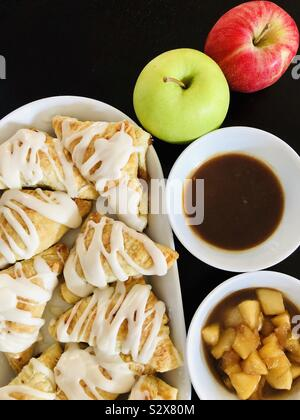 Apple turnovers baking for the fall - Stock Photo