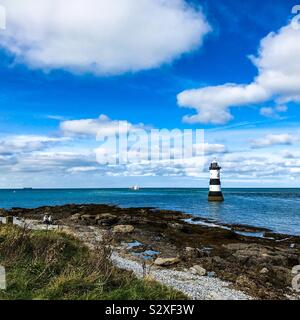 Trwyn Du or Penmon lighthouse between Black point and Puffin Island on the Menai Straits - Stock Photo