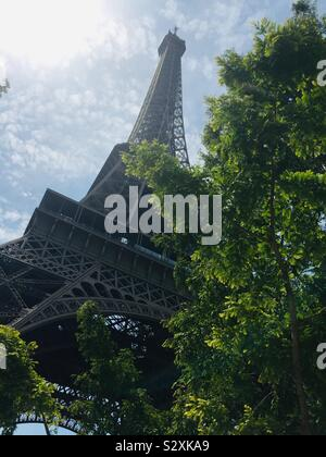 Eiffel Tower in Paris, France during the summer of 2019. A view from below. - Stock Photo
