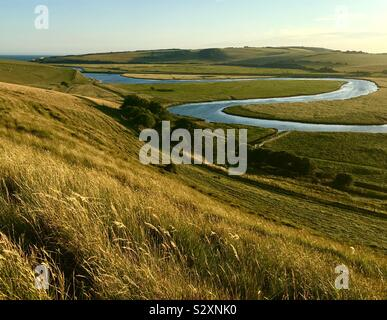 The River Cuckmere meanders through Cuckmere Haven in East Sussex. - Stock Photo