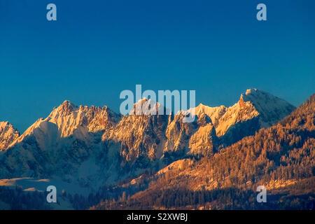 The Wild Kaiser at sunset in the Kaiser Mountains alps Tirol austria - Stock Photo