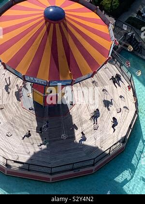 Top view of the swing ride, chair swing ride, swing carousel, wave swinger, yo-yo, waver swinger, Chair-O-Planes, Dodo, swinger, amusement and thrilling entertainment ride. - Stock Photo