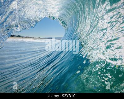 Inside, looking out of a barreling wave. Manhattan Beach, California USA. - Stock Photo