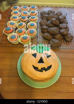Halloween cakes baked for a Halloween birthday party, home made. - Stock Photo