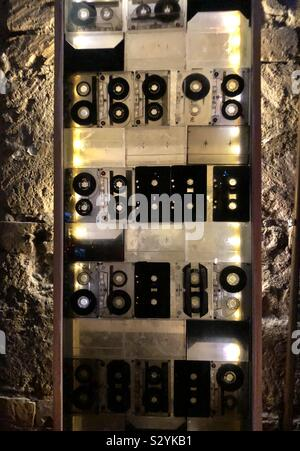 Old audio cassette tapes in a light display in a ruin bar in Budapest - Stock Photo