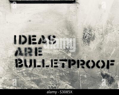"""HongKong, Hong Kong - November, 2019: """"Ideas are bulletproof"""" political graffiti during protest in HongKong - Stock Photo"""