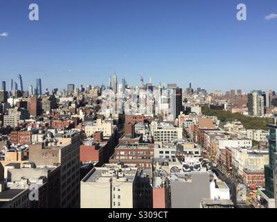 View from lower east side looking north over Manhattan, New York City, USA - Stock Photo