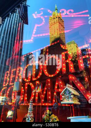 Reflections of skyscrapers in the Christmas holiday windows at Bergdorf Goodman, a department store on Fifth Avenue in Manhattan, New York City, USA - Stock Photo