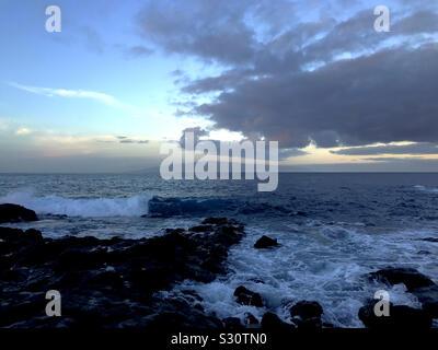 Dawn at the coast in Fonsalia looking west to La Gomera from Tenerife, Canary Islands - Stock Photo