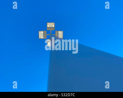 Abstract deep blue sky and LED public lights, low angle view - Stock Photo