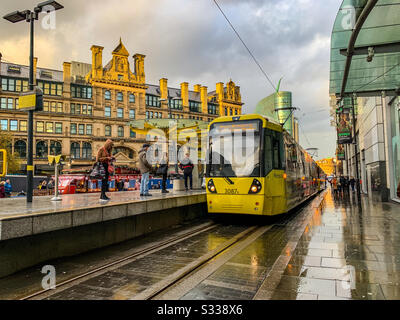 Metrolink tram arriving at exchange square tram stop in Manchester - Stock Photo