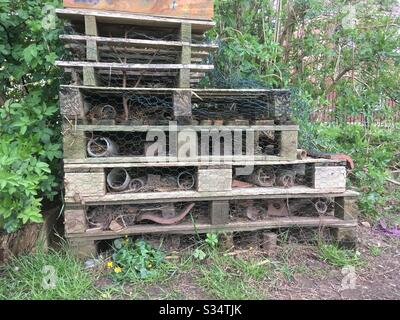 A bug house made from various materials, in a park - Stock Photo