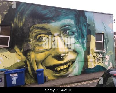 Street art picture of Professor Stephen Hawking in Bedminster, Bristol, UK. The wall art was painted in 2018 by American artist ARCY as part of Upfest, Europe's largest street art festival - Stock Photo