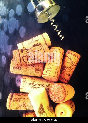 Corks and corkscrew in dappled sunlight - Stock Photo