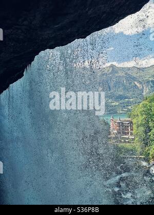 Grandhotel Giessbach, Brienz, Switzerland from behind waterfall - Stock Photo