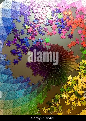 Completing a large jigsaw puzzle - Stock Photo