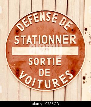 No Parking! Sign on a garage door in a French village. - Stock Photo
