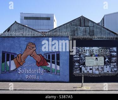 Part of a Republican mural in Northumberland Street in the Falls Road area of Belfast Northern Ireland. These murals are famous symbols of the political and religious divides of the past. - Stock Photo