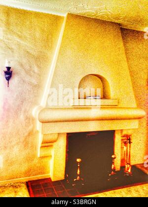 Vintage plaster fireplace in old California Spanish hacienda style. 1920s house in Inglewood, Los Angeles, CA, USA Stock Photo