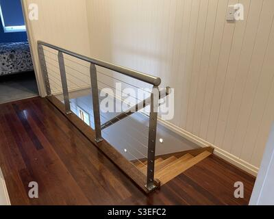 Interior staircase with stainless steel balustrade and wire railing