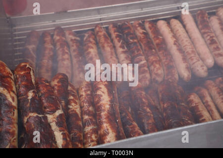 Erfurt, Germany. 16th Mar, 2019. Thuringian grilled sausages lie on a charcoal grill at the opening of the barbecue season 'RostKultur - Thüringen glows on'. 13 manufacturers of original Thuringian bratwursts present their sausages on the cathedral square. Credit: Bodo Schackow/dpa-Zentralbild/dpa/Alamy Live News - Stock Photo