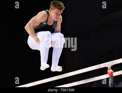 Liverpool, UK. 16th March, 2019. (89) performs Parallel Bar in Men's Under 18 during the 2019 Gymnastics British Championships at M&S Bank Arena on Saturday, 16 March 2019. LIVERPOOL ENGLAND. (Editorial use only, license required for commercial use. No use in betting, games or a single club/league/player publications.) Credit: Taka G Wu/Alamy News - Stock Photo