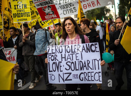 Athen, Greece. 16th Mar, 2019. A woman at a demonstration against racism in the Greek capital wears a sign saying 'Zero tolerance for hatred ! Love and Solidarity for New Zealand from Greece' (Zero Tolerance for Hate! Love and Solidarity to New Zealand from Greece) Credit: Angelos Tzortzinis/DPA/Alamy Live News - Stock Photo