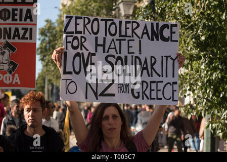 Athens, Greece. 16th March 2019. A protester holds a placard with a message of solidarity to the victims of the racist attack in New Zealand. Leftist and anti-racist organizations staged a rally on the occasion of the International Day against racism to demonstrate against discrimination and racist policies and behaviours. © Nikolas Georgiou / Alamy Live News - Stock Photo