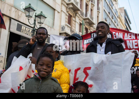 Athens, Greece. 16th March 2019. Migrants and refugees hold placards and shout slogans against racism and closed borders as well as against the greek neo-Nazi party Golden Dawn, currently on trial with accusations such as criminal organization, murder, possession of weapons and racist violence. Leftist and anti-racist organizations staged a rally on the occasion of the International Day against racism to demonstrate against discrimination and racist policies and behaviours. © Nikolas Georgiou / Alamy Live News - Stock Photo
