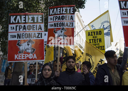 Athens, Greece. 16th Mar, 2019. Migrants and refugees hold placards and shout slogans against racism and closed borders as well as against the greek neo-Nazi party Golden Dawn, currently on trial with accusations such as criminal organization, murder, possession of weapons and racist violence. Leftist and anti-racist organizations staged a rally on the occasion of the International Day against racism to demonstrate against discrimination and racist policies and behaviours. Credit: Nikolas Georgiou/ZUMA Wire/Alamy Live News - Stock Photo