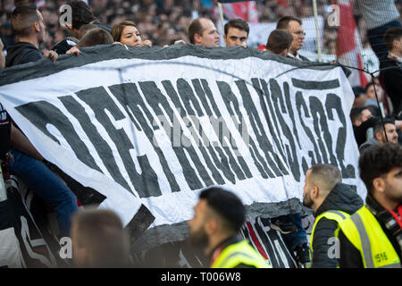 Stuttgart, Germany. 16th Mar, 2019. Soccer: Bundesliga, VfB Stuttgart - 1899 Hoffenheim, 26th matchday in the Mercedes-Benz Arena. VfB fans hold out a poster with the inscription 'Dietrich raus' and thus refer to club president Dietrich. Credit: Sebastian Gollnow/dpa - IMPORTANT NOTE: In accordance with the requirements of the DFL Deutsche Fußball Liga or the DFB Deutscher Fußball-Bund, it is prohibited to use or have used photographs taken in the stadium and/or the match in the form of sequence images and/or video-like photo sequences./dpa/Alamy Live News - Stock Photo
