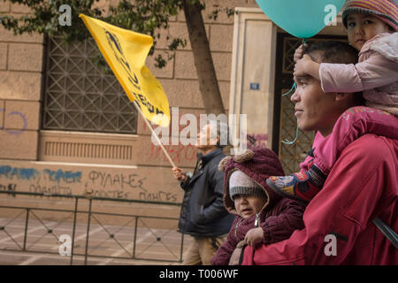 Athens, Greece. 16th Mar, 2019. A father with his children are seen during the demonstration.Thousands of people took place in a protest during the international day against racism and fascism in Athens. Credit: Nikolas Joao Kokovlis/SOPA Images/ZUMA Wire/Alamy Live News - Stock Photo