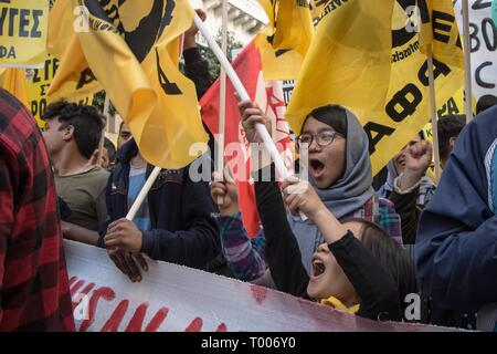 Athens, Greece. 16th Mar, 2019. Protesters are seen shouting slogans while holding flags at the demonstration.Thousands of people took place in a protest during the international day against racism and fascism in Athens. Credit: Nikolas Joao Kokovlis/SOPA Images/ZUMA Wire/Alamy Live News - Stock Photo