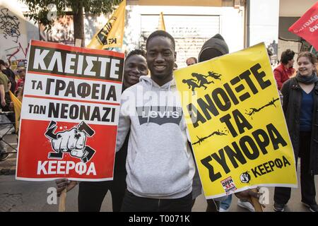 Athens, Greece. 16th Mar, 2019. A protester seen holding placards during the demonstration.Thousands of people took place in a protest during the international day against racism and fascism in Athens. Credit: Nikolas Joao Kokovlis/SOPA Images/ZUMA Wire/Alamy Live News - Stock Photo