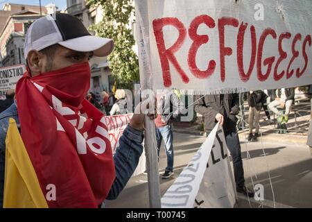 Athens, Greece. 16th Mar, 2019. A protester seen holding a banner during the demonstration.Thousands of people took place in a protest during the international day against racism and fascism in Athens. Credit: Nikolas Joao Kokovlis/SOPA Images/ZUMA Wire/Alamy Live News - Stock Photo