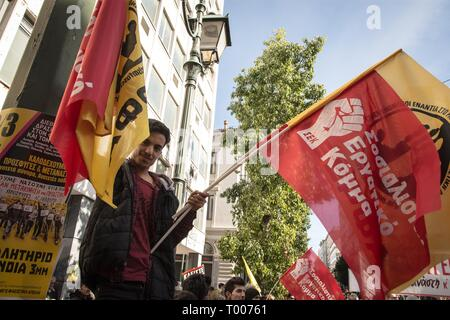 Athens, Greece. 16th Mar, 2019. A protester seen holding flags during the demonstration.Thousands of people took place in a protest during the international day against racism and fascism in Athens. Credit: Nikolas Joao Kokovlis/SOPA Images/ZUMA Wire/Alamy Live News - Stock Photo