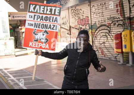Athens, Greece. 16th Mar, 2019. A protester seen holding a placard during the demonstration.Thousands of people took place in a protest during the international day against racism and fascism in Athens. Credit: Nikolas Joao Kokovlis/SOPA Images/ZUMA Wire/Alamy Live News - Stock Photo