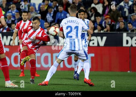 Leganes, Madrid, Spain. 16th March 2019. Girona's Borja García (L) vies for the ball against Leganes' Rubén Pérez during the Spanish La Liga soccer match between Girona and Leganes at the Butarque staidum in Leganes, Madrid, Spain. EFE/Kiko Huesca Credit: EFE News Agency/Alamy Live News - Stock Photo