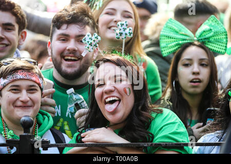New York, USA. 16th Mar, 2019. People watch the St. Patrick's Day Parade in New York, the United States, on March 16, 2019. Hundreds of thousands of people gathered alongside New York's Fifth Avenue to watch the St. Patrick's Day Parade here on Saturday. Credit: Wang Ying/Xinhua/Alamy Live News - Stock Photo