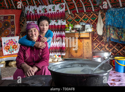 Bayan Ulgii, Mongolia, 29th September 2015: kazakh nomad mother and daughter in their home yurt kitchen area - Stock Photo