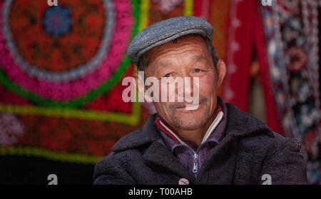 Bayan Ulgii, Mongolia, 29th September 2015: mongolian kazakh nomad man resting in his home yurt - Stock Photo