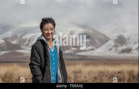 bayan Ulgii, Mongolia, 29th September 2015: mongolian kazakh nomad woman in a landscape of western mongoilia - Stock Photo